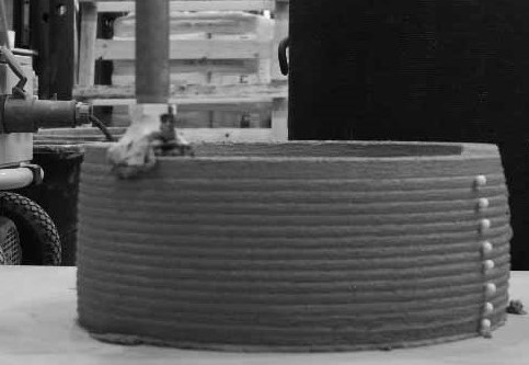 Surface modification as a technique to improve inter-layer bonding strength in 3D printed cementitious materials